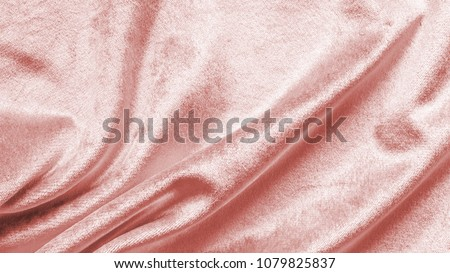 Rose gold pink velvet background or velour flannel texture made of cotton or wool with soft fluffy velvety satin fabric cloth metallic color material in wavy satin pattern #1079825837