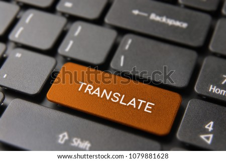 Language translation service concept, red computer button with translate text for multilingual support.