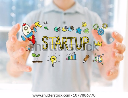 Startup with young man holding his hands #1079886770