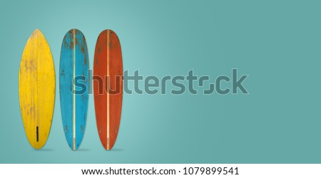 Vintage surfboard on color background. flat lay, top view hero header. vintage color styles.