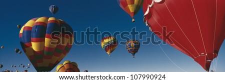 Hot air balloons in air at Albuquerque Int'l Balloon Festival #107990924