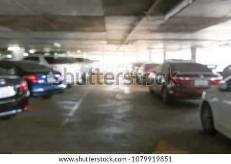 Blurred of Many cars in the parking garage #1079919851