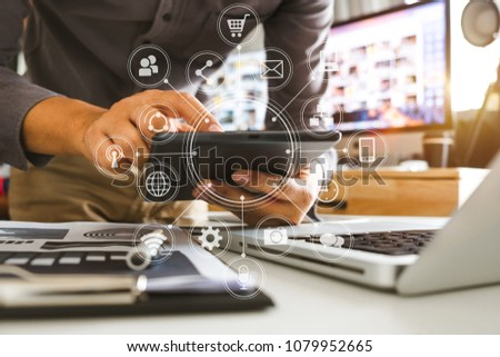 businessman or Designer using smart phone with laptop and digital tablet computer and document on desk in modern office with virtual interface graphic icons network diagram  #1079952665