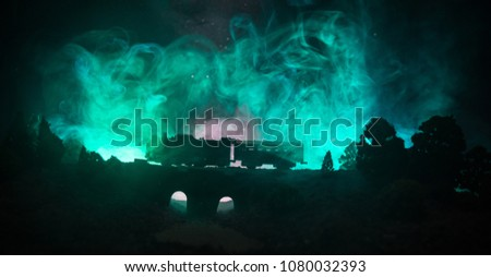 Train moving in fog. Ancient steam locomotive in night. Night train moving on railroad. toned foggy fire background. Horror mystical scene. Selective focus #1080032393