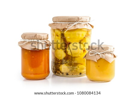 Pickled vegetables and colorful jams in glass jars isolated on white background.  #1080084134