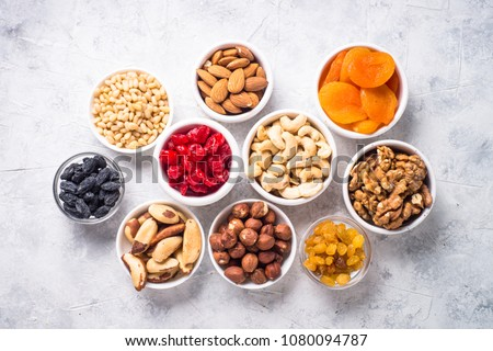 Nuts and dried fruits assortment on stone table top view. #1080094787