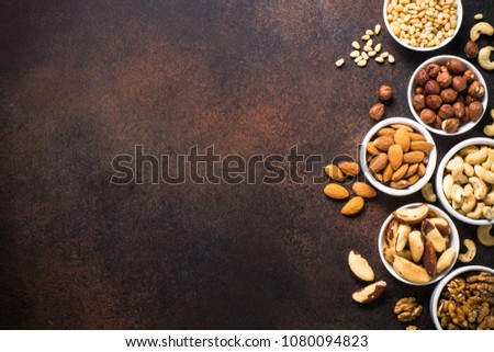 Nuts assortments on stone table top view. #1080094823