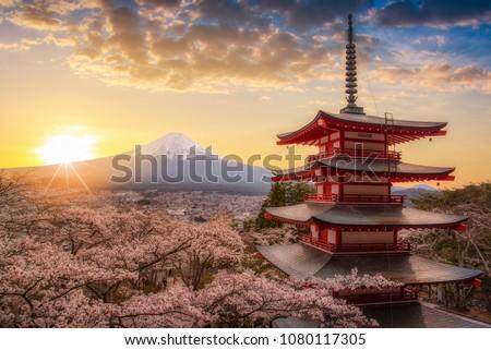 Mount Fuji san beautiful landscapes on sunrise. Fujiyoshida, Japan at Chureito Pagoda and Mt. Fuji in the spring with cherry blossoms.  #1080117305