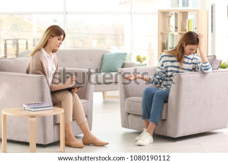 Young female psychologist working with teenage girl in office #1080190112