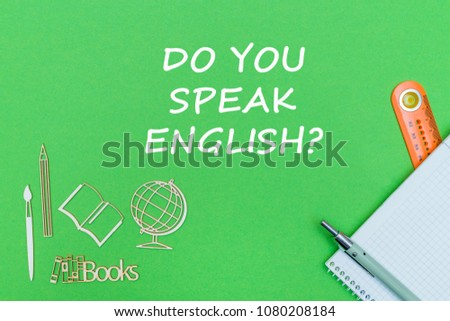 concept school, text do you speak english, school supplies, notebook, ruler and pen on green backboard #1080208184