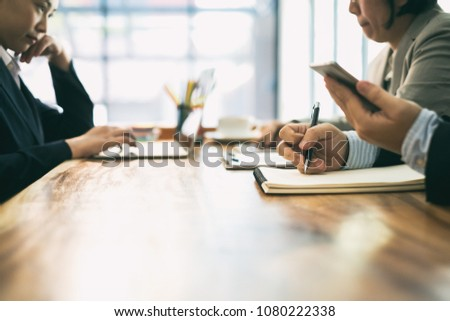 Young businessman work with mobile phones and notebooks in the office., business concept #1080222338