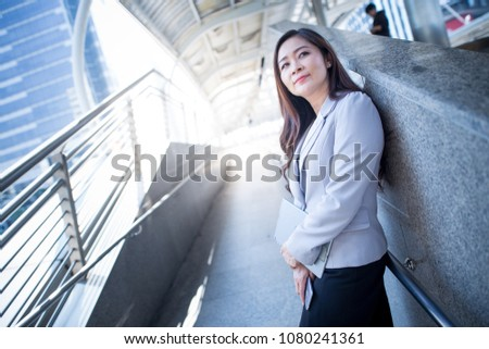 Businesswomen standing and thinking #1080241361