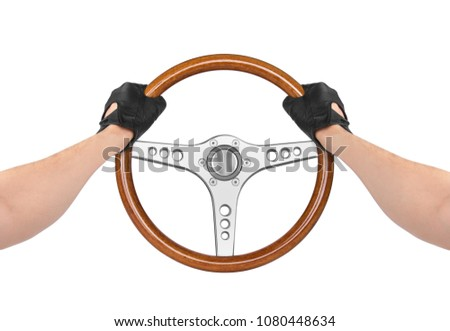 Hands holding steering wheel isolated on white #1080448634