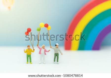 Miniature family with balloon and rainbow  using as background international family day concept. #1080478814