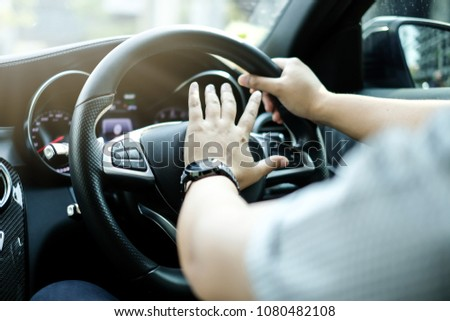 Close up Hand Honking while Driving on Luxury Car #1080482108