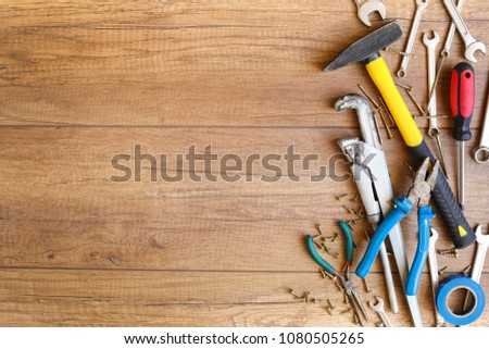 A lot of wrenches. The working set of wrenches on wooden background. Tooling. #1080505265