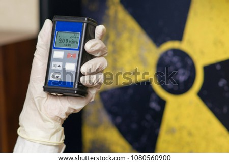 Geiger counter with radioactive materials in the background #1080560900