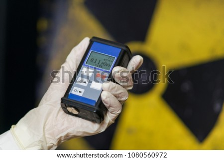 Geiger counter with radioactive materials in the background #1080560972