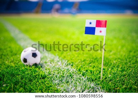 MOSCOW, RUSSIA - APRIL, 24, 2018: Panama national Flag and football ball on green grass. Fans, support photo, edit space #1080598556