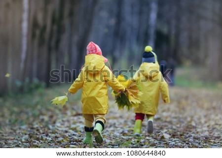 Little children are walking in the autumn park in the fall of leaves #1080644840