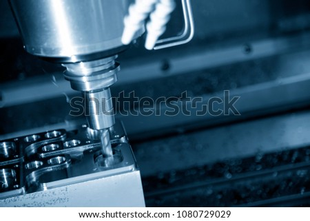 The CNC milling machine cutting the metal injection mold part with the solid square endmill tool. High technology manufacturing process. #1080729029