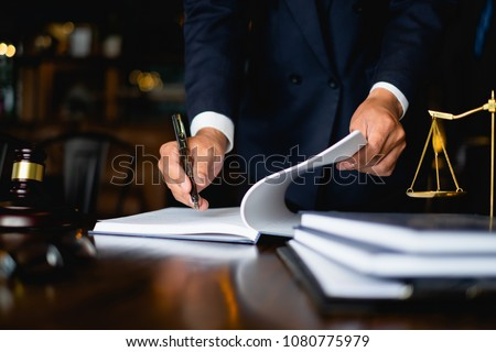 Close up lawyer businessman working or reading lawbook in office workplace for consultant lawyer concept. #1080775979