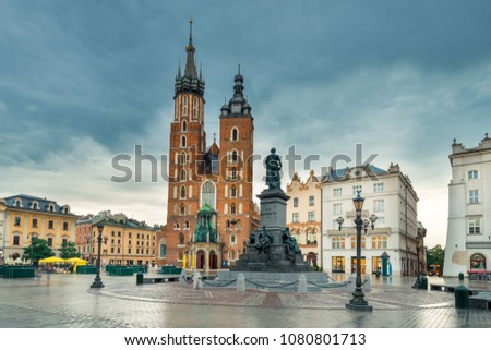 Krakow, Poland - The Church of Mary and the Monument in the Main Square of the City #1080801713