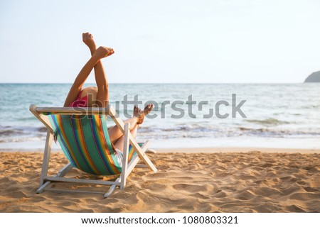 Summer beach vacation concept, Asia woman with hat relaxing and arm up on chair beach at Koh Mak, Trad, Thailand #1080803321