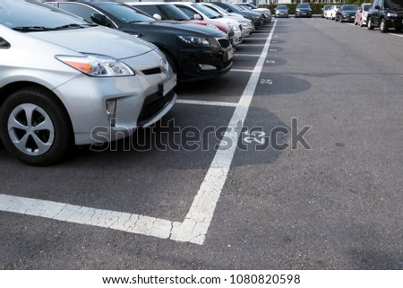 Cars on a parking #1080820598