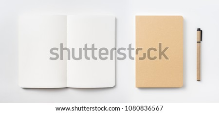 Design concept - Top view of hardcover kraft notebook and ballpoint pen isolated on white background for mockup Royalty-Free Stock Photo #1080836567