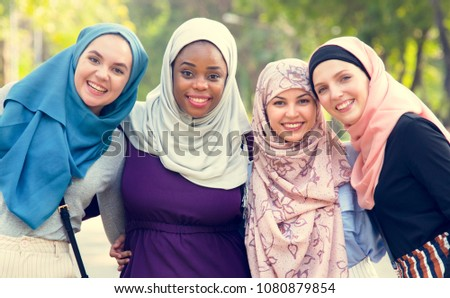 Group of islamic friends embracing and smiling together #1080879854