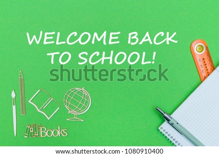 concept school, text welcome back to school, school supplies, notebook, ruler and pen on green backboard #1080910400