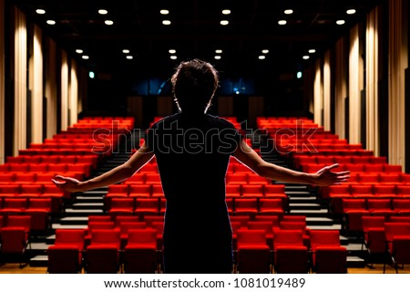 Young actor in a theater. Royalty-Free Stock Photo #1081019489