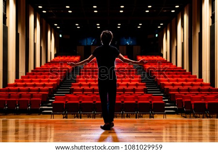 Young actor in a theater. Royalty-Free Stock Photo #1081029959