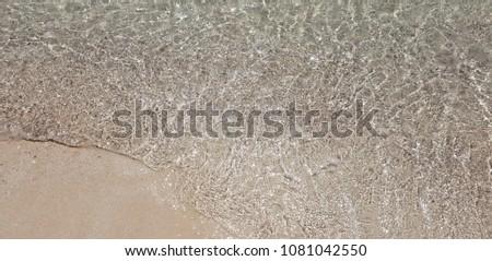 Red Sea clear Water beach sand #1081042550
