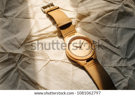 crafted wooden wrist watch is one of timeless accessory for a couple and suits for a memorable gift for any anniversary in dingy light. #1081062797