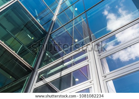 The glass architecture in city against a sky . #1081082234