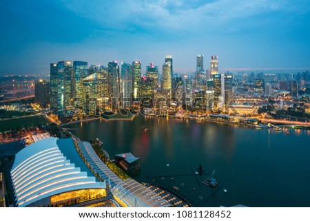 Aerial view of Singapore business district and city at night in Singapore, Asia. #1081128452