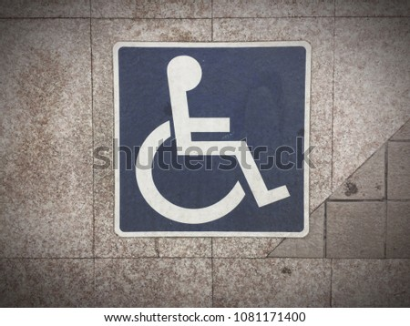 wheelchair sign on wall #1081171400