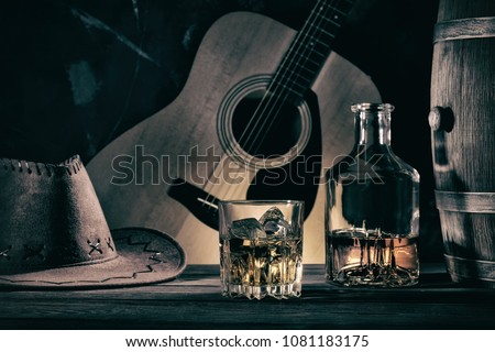 Cowboy Still Life Against Guitar Background
