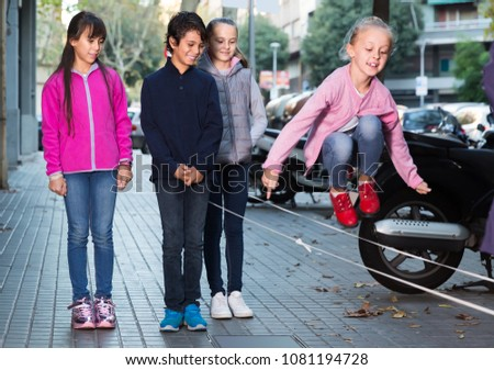 cheerful children play on street in good weather #1081194728