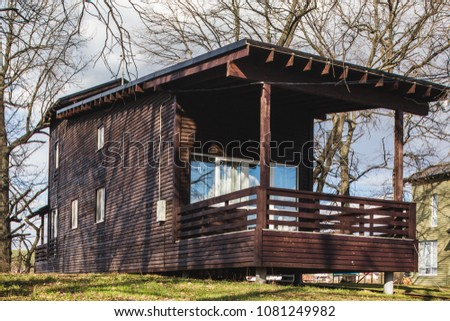 design wooden cottage cabin in forest around river, early spring time #1081249982