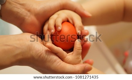 mother helping hand with baby with care and love #1081271435