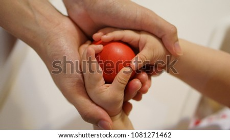 mother helping hand with baby with care and love #1081271462