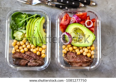 Healthy meal prep containers with chickpeas, goose meat , tomatoes, avocado, lemon and spinach. Top view #1081277750
