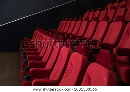 Empty comfortable red seats in cinema #1081338566