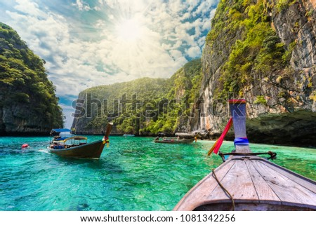 Traditional long tail boat on the sea in Loh Samah Bay, Phi Phi island, Thailand #1081342256