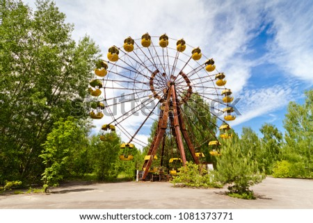 The abandoned Ferris wheel in the amusement park in a dead city Pripyat, Ukraine. Chernobyl nuclear power plant zone of alienation #1081373771
