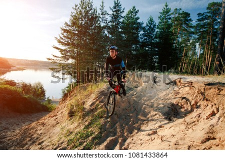 Mountain biker riding on bike in autumn inspirational mountains landscape. Man cycling MTB on enduro trail track. Sport fitness motivation and inspiration. #1081433864