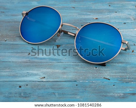 blue sunglasses on a blue background.  #1081540286